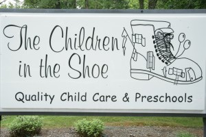 The Children in the Shoe child care sign
